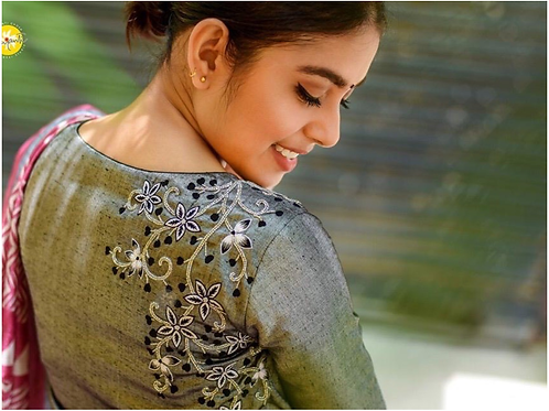 Grey silver blouse with embroidery.