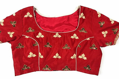Red blouse with white&gold embroidery .
