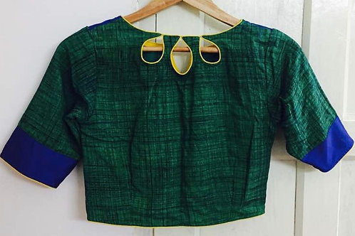 Green ikkat V-cut blue yellow piping
