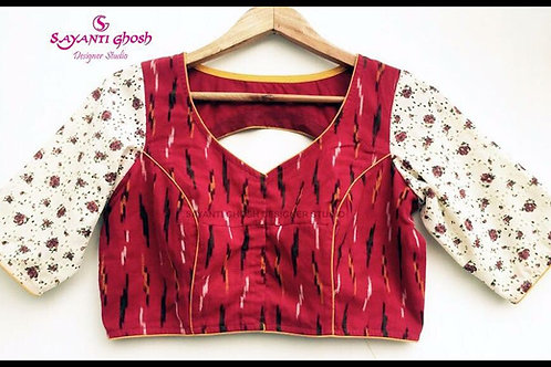 Cotton Ikkat Blouse with embroidery Sleeve.