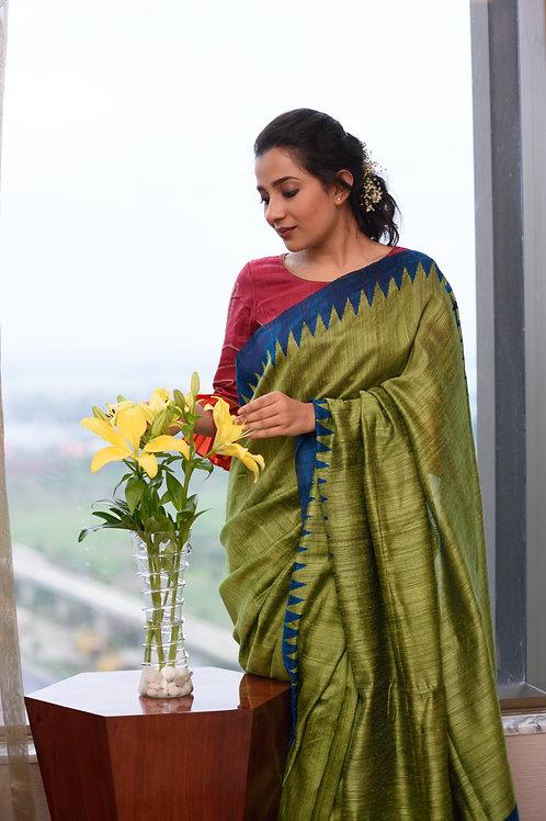 Matka green saree with blue border.