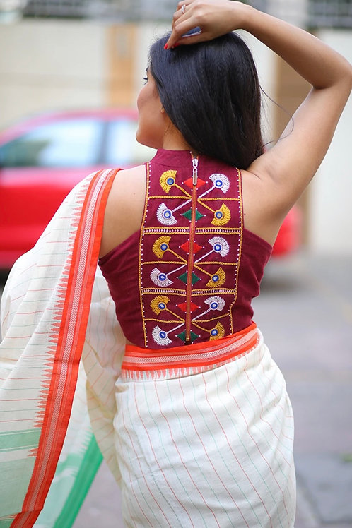 Maroon Kotpad with a T-Back cut and colorful glasswork embroidery is a blouse th
