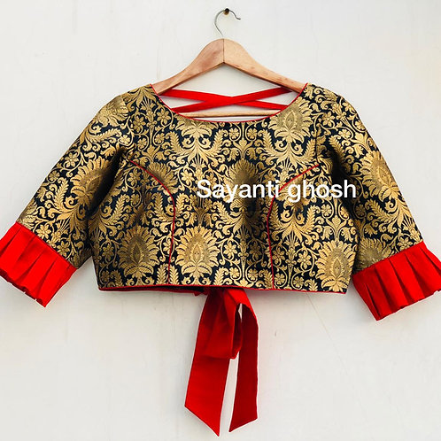 Black Benerasi brocade with red ribbon .