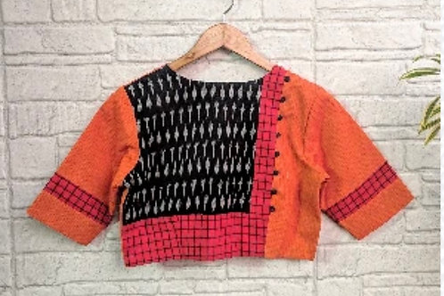 Orange ribbed blouse with ikkat .