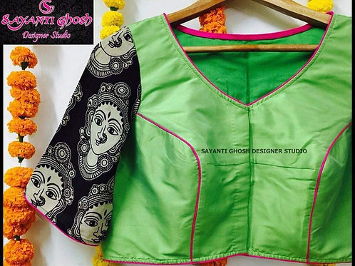 Green silk with face print sleeves..