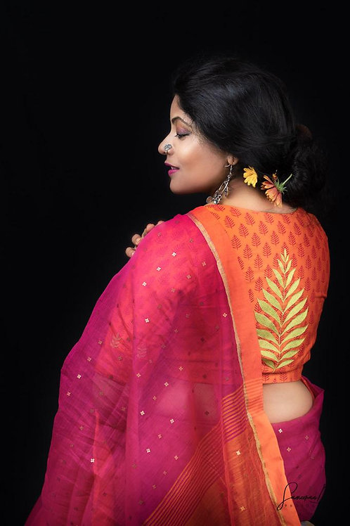 Orange blouse with leaf embroidery..