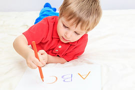 Preschool Child Writing Alphabet
