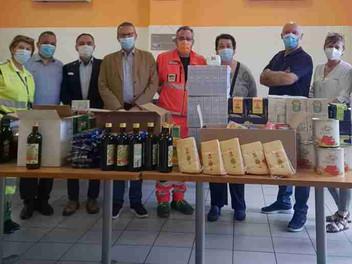 09.06.2021 - Donazione di derrate alimentari e una sedia a rotelle a Torino