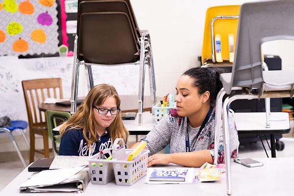 Kylee mentors a student during after-school tutoring