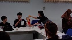 Sharing Korean snacks.