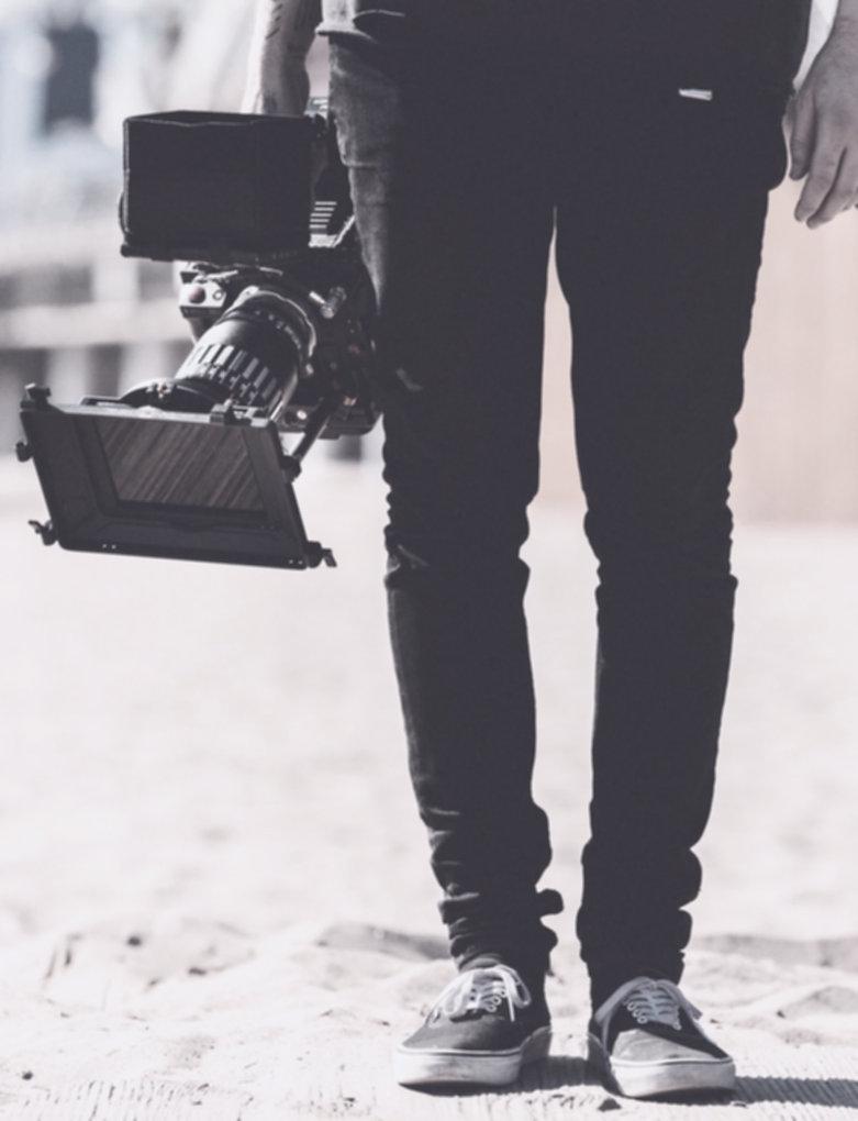 Man Holding Camera_edited_edited_edited_edited.jpg
