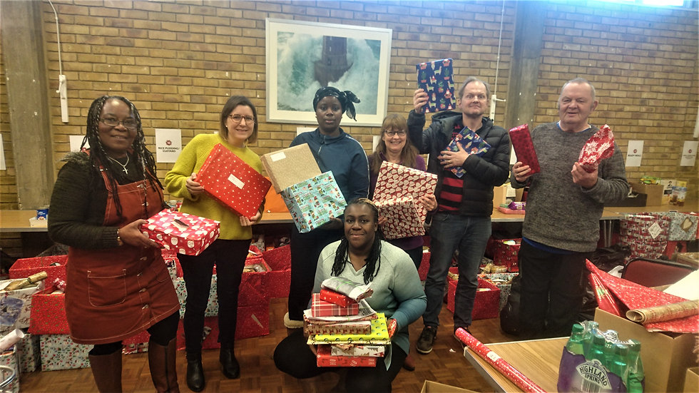 Volunteers packing toys for Voluntary Services Lewisham 2019