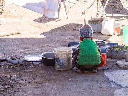 A local Ladakhi girl washing her hands o