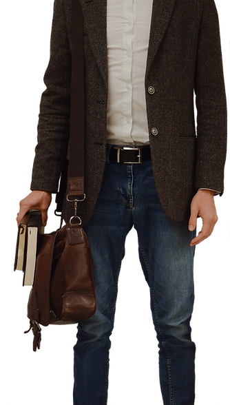 Michael Baumann stands in blue jeans and a gray blazer carrying a brown meseenger bag and two untitled books. This decorative image is croped from shoulder to shin.