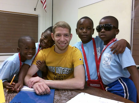 Michael Baumann with students at the Saint Florian Leadership Center during the Indiana Writers Center summer youth memoir program, Building a Rainbow