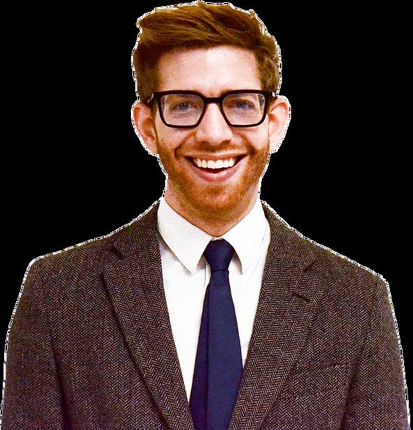 A smiling photograph of Professor Michael Baumann, a caucasian man with glasses, a tie, a beard.