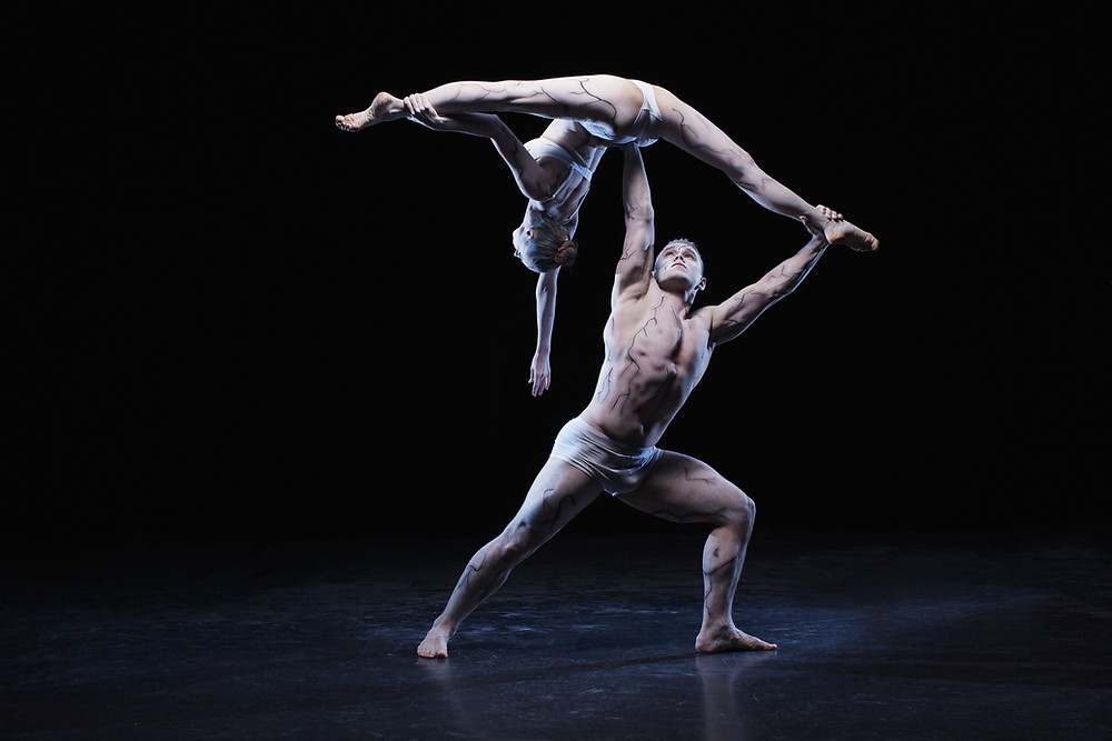 a man and a woman demonstrate great flexibility