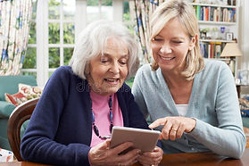 female-neighbor-showing-senior-woman-how