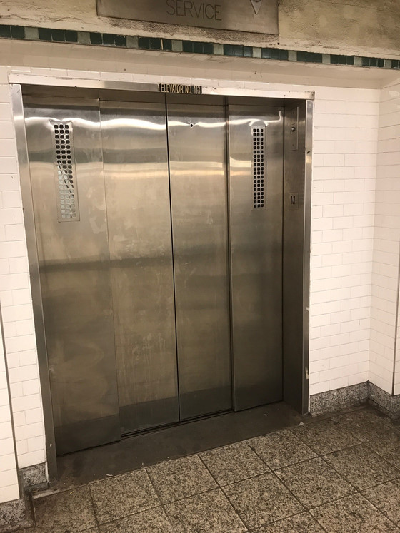 Want this elevator door with big beautiful glass windows?