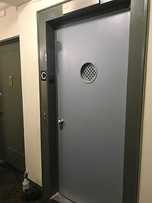 Elevator door made to fit existing entrance