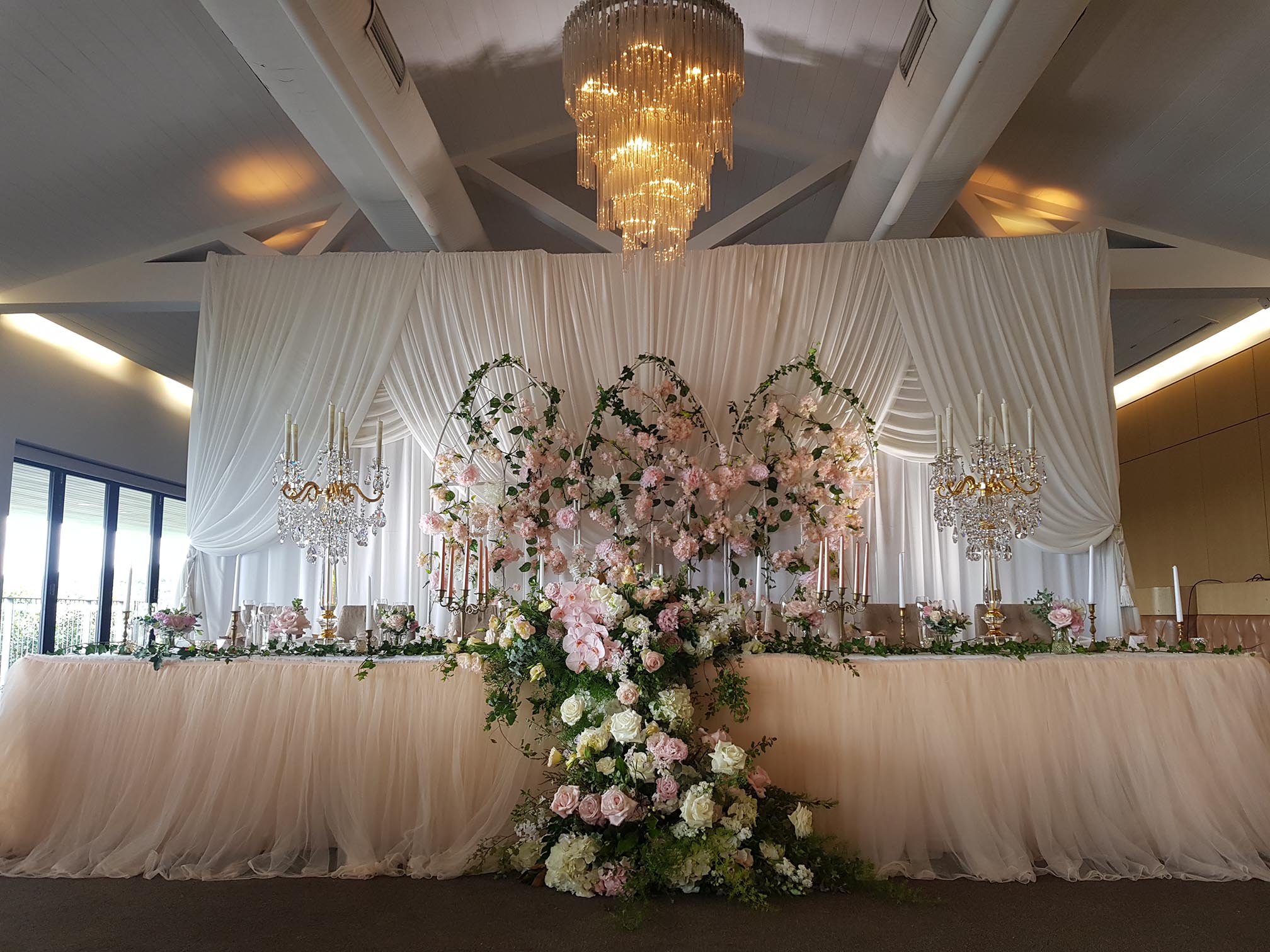 off white backdrop with blush tulle skir