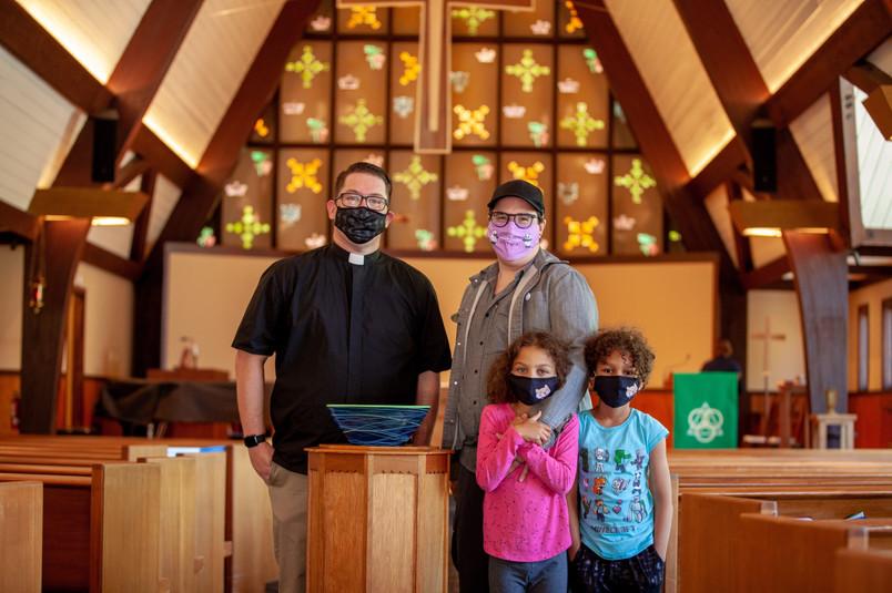Pastor Joshua Serrano of Holy Trinity Lutheran Church in San Carlos, CA with Bishop Megan Rohrer and Kids