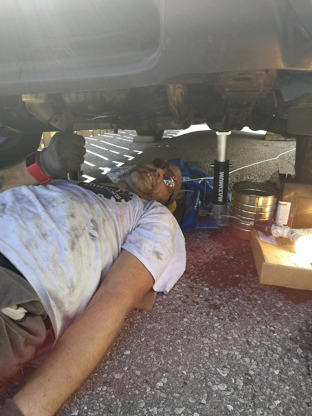 This is me laying on my dirty driveway fixing my 2003 Subaru Forester.