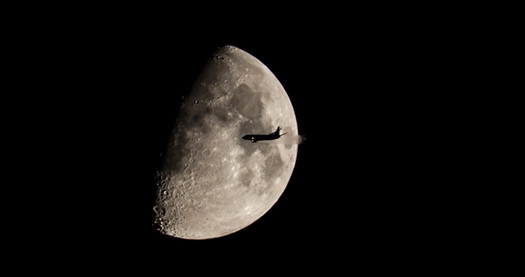 Flying to the Dark Side of the Moon