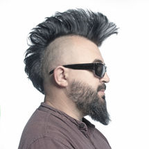 A man with a mohawk and beard, isolated.