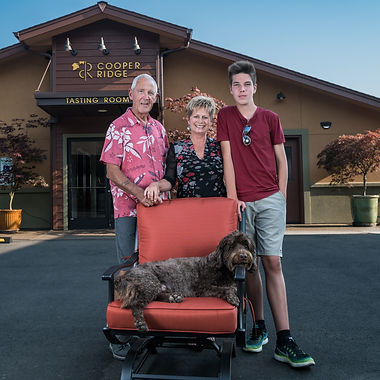 Winery owners Robin, Lesa and Cooper Ray with dog, Charlie.