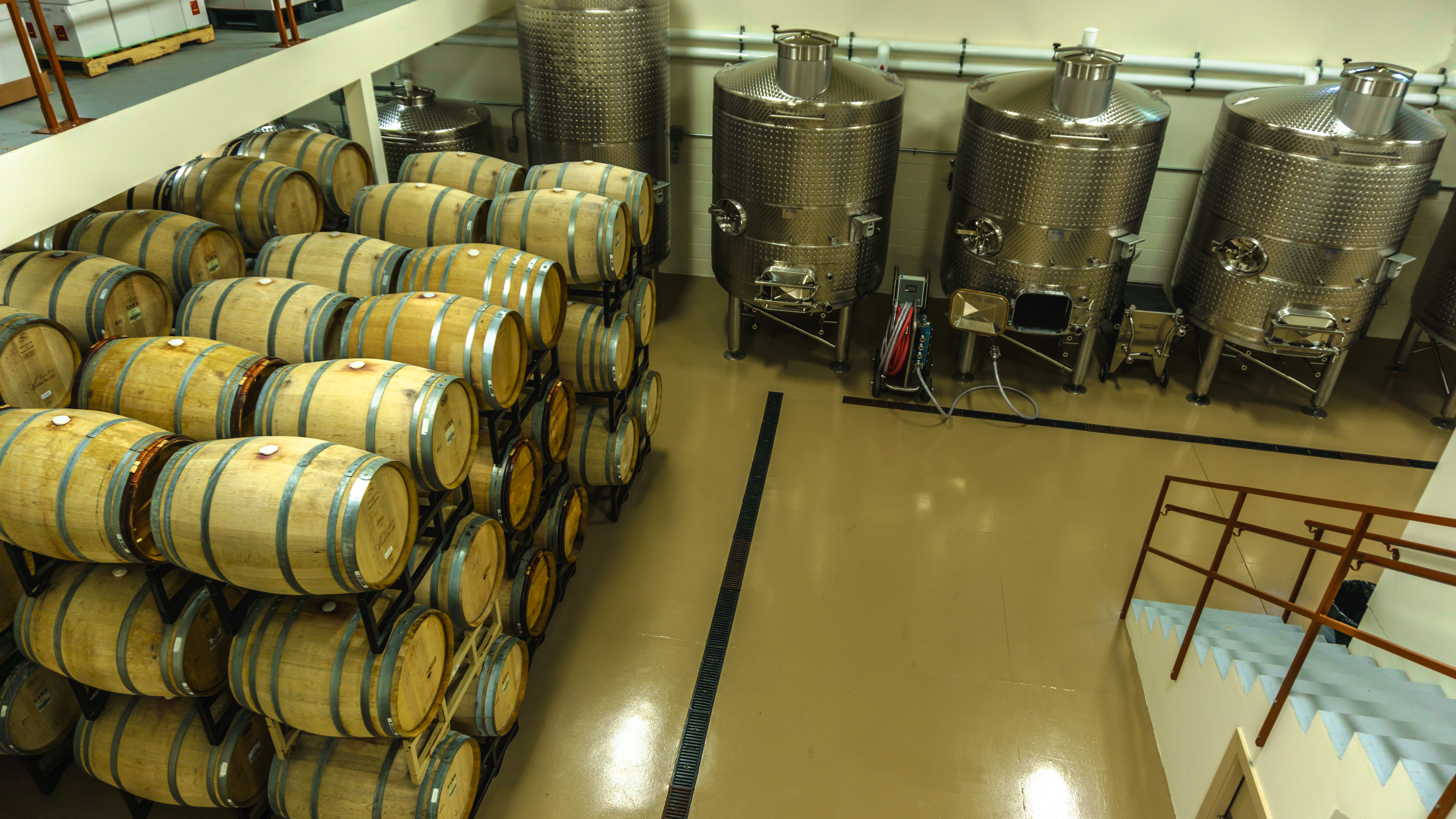 Steel tanks and wine barrels winery