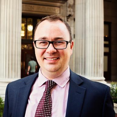 Travis J. Robertson