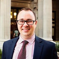 Travis J Robertson