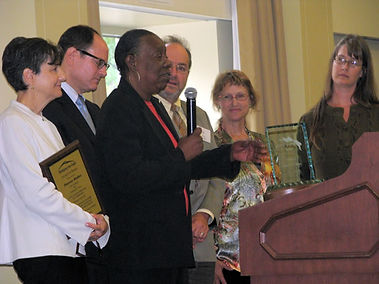 group of people accepting an award
