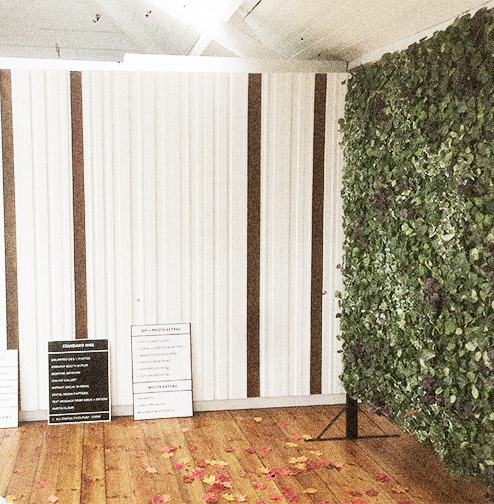 photo booth backdrop with foliage at The Boiler Shop in Newcastle upon Tyne.