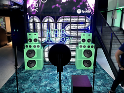 photo booth set up with vibrant bespoke backdrop installation