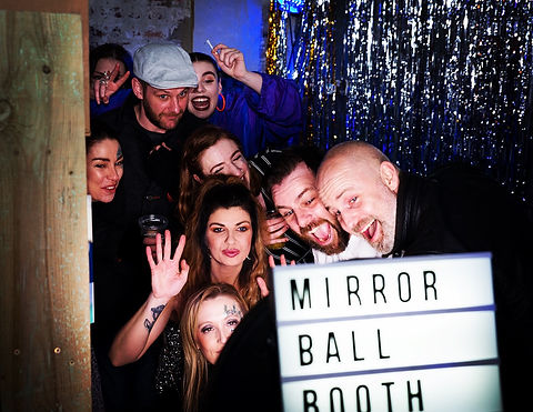 group of friends in the gif booth at Alphabetti Theatre in Newcastle upon Tyne