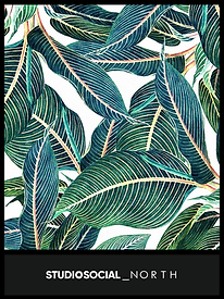 photo booth backdrop with large tropical leaf design