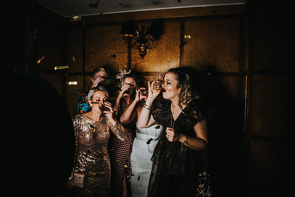 bride and friends drinking a shot in a photo booth with 1920's props at The Vermont Hotel, Newcastle upon Tyne