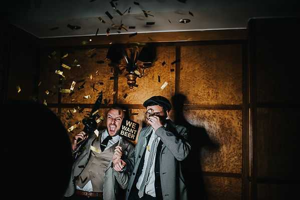 two men using a photo booth with 1920's props at The Vermont Hotel, Newcastle upon Tyne