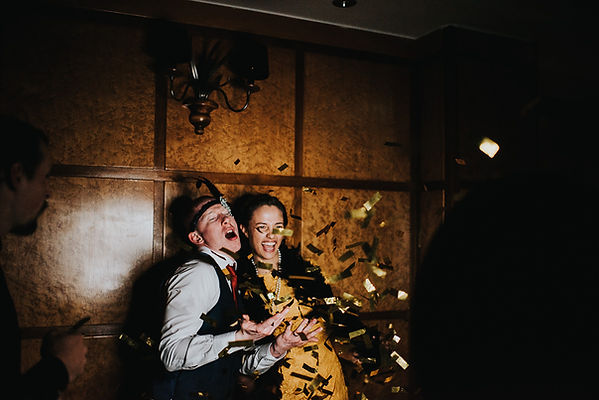 young man and young woman using a photo booth with 1920's props at The Vermont Hotel, Newcastle upon Tyne