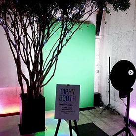 studio style photo booth with green screen backdrop for creating giphy stickers