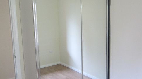 383885-Mirror doors with chrome frames.J