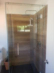 Hinged Door Box Shower with Wooden Tile Walls