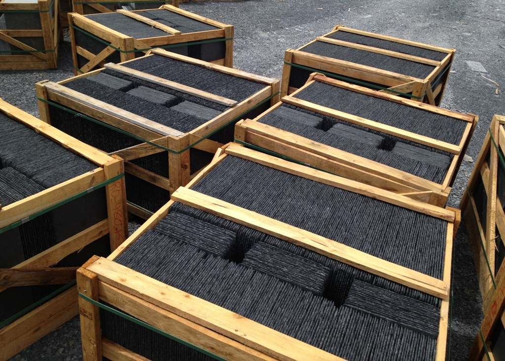 Black roofing slate in crates