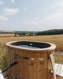Wood-fired hot tub outside Maggie