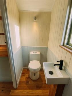 Both huts have flushing toilets!
