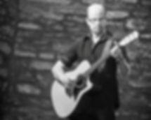 Tim Dallman playing guitar
