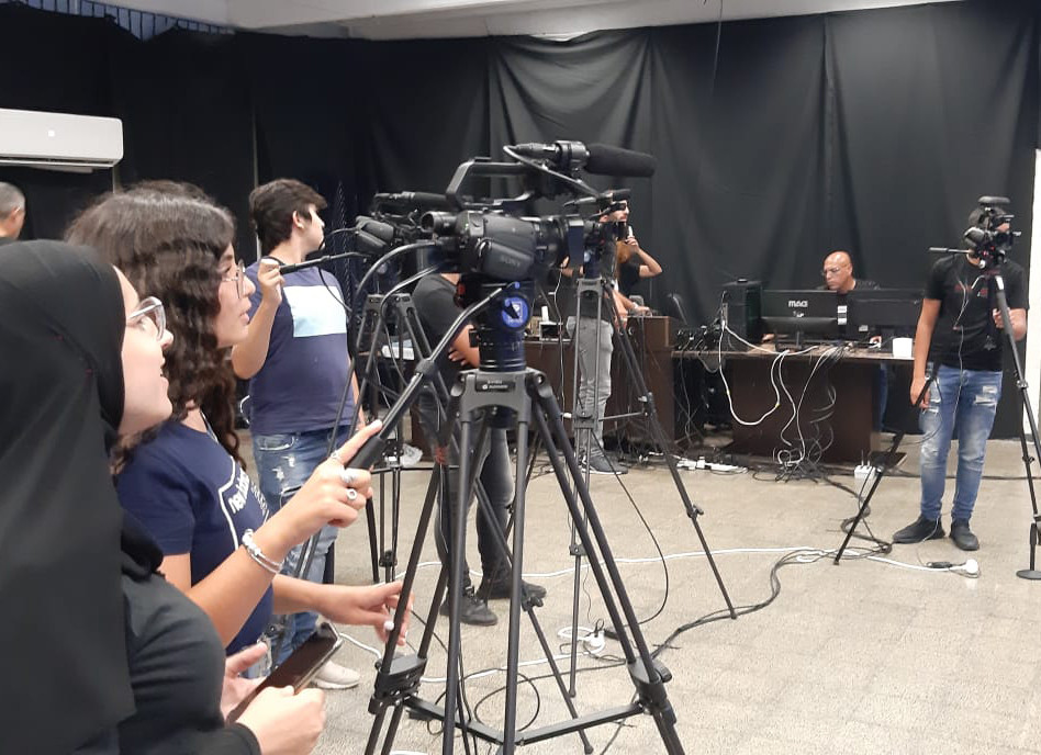 A-CAT youth filming a community TV show
