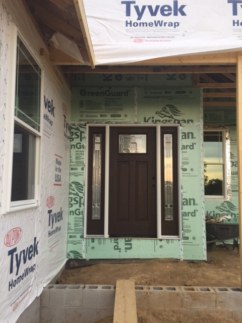 The Amish workers continue to amaze us. In one day, they flawlessly installed all the windows along with the doors that were on site. The French doors haven't arrived yet. I wanted a very dark front entry door to contrast with the siding and trim, all of which are white,.